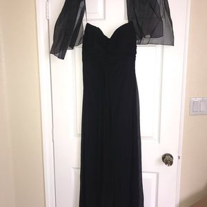 Long black strapless chiffon dress.